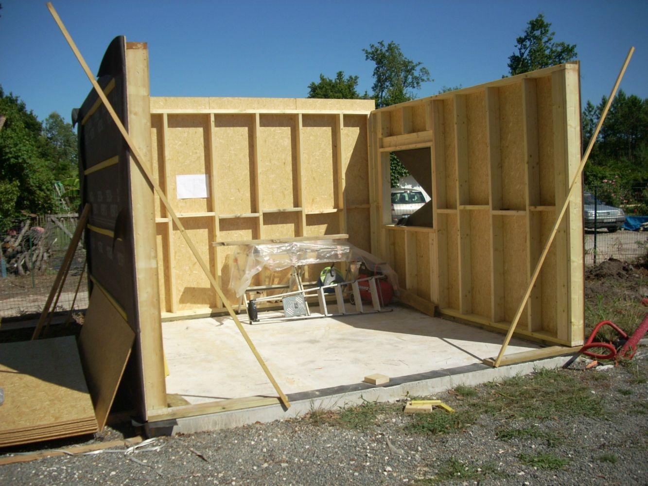 Garage ossature bois artisan charpente menuiserie for Devis garage ossature bois