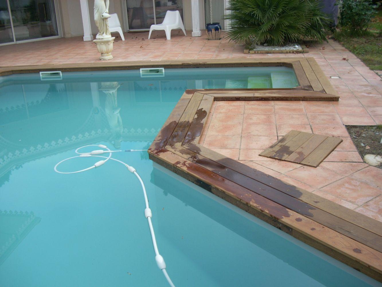 Margelle de piscine en bois artisan charpente menuiserie for Depassement margelle piscine